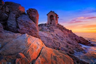 Tiny chapel on a rock by the sea