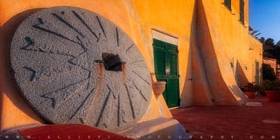 An old olive millstone at the Varigotti hamlet, Italy