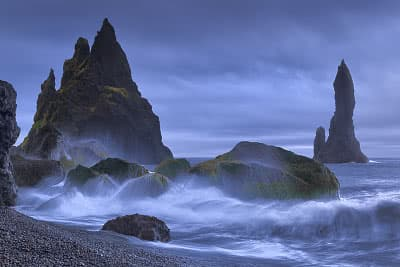 Waves crashing on a beach near the Vik town in Iceland